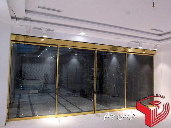 درب اتوماتیک شیشه ای فریم استیل طلایی